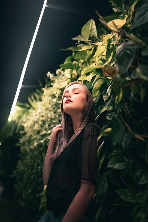Stylish woman with eyes closed in garden