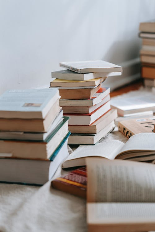 Close-Up Photo of Stack of Books