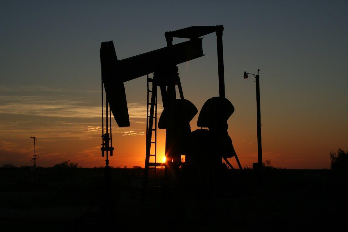 Oil Pump Machine Under Orange Sunset