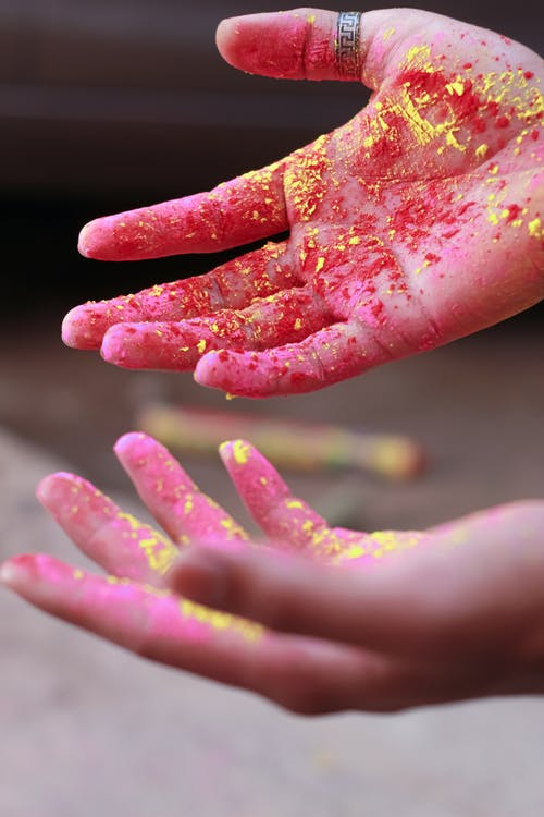 Person With Holi Powder on Hands