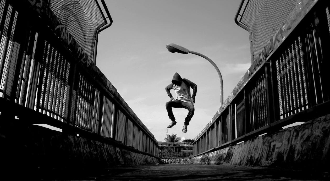 Man Jumping on Air Wearing Gray Hoodie