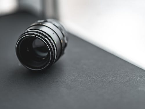 Black Camera Lens on Gray Table