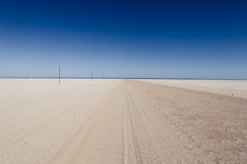 Free stock photo of blue sky, desert, desert meets sea, dry landcsape