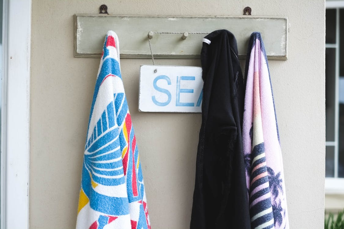 Free stock photo of beach house, seaside, towels on hook