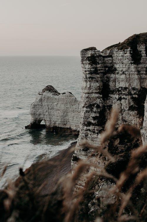 Rocky cliff near rippling sea