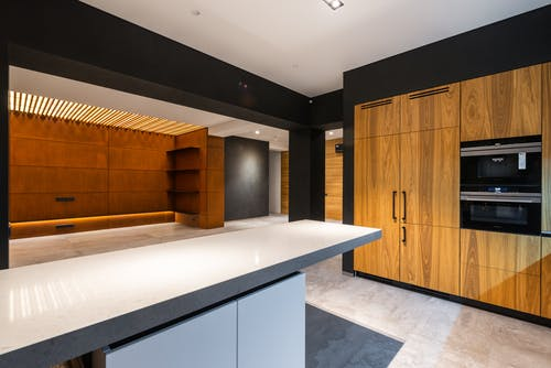Contemporary kitchen and corridor interior with furniture in house