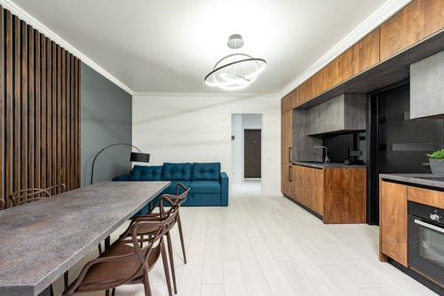 Modern kitchen interior with furniture in light house