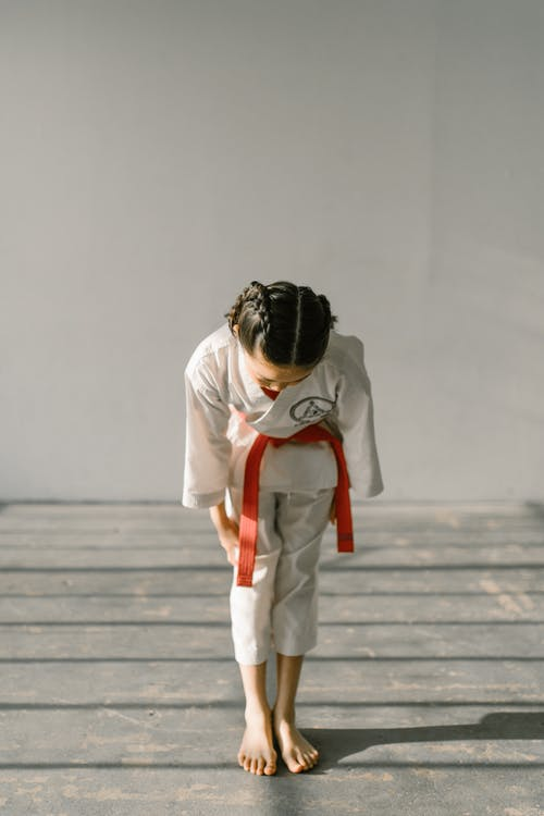 A Girl Wearing a Red Belt
