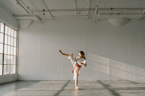 A Girl Practicing Taekwondo