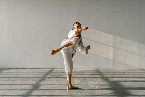A Girl Wearing White Pants