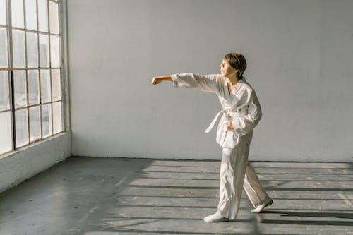 A Boy Wearing White Pants