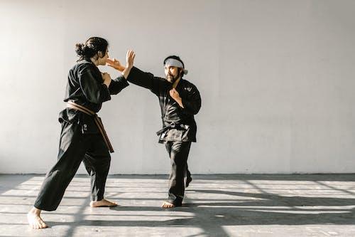 Men Practicing Taekwondo