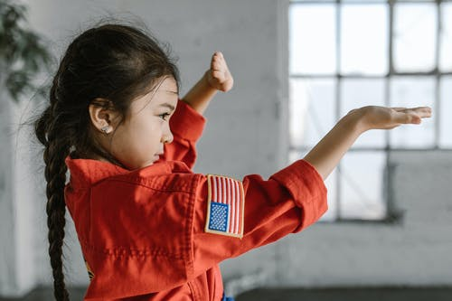 Photo of a Child Wearing Red Dobok