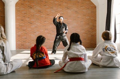 Man Wearing a Black Taekwondo Uniform