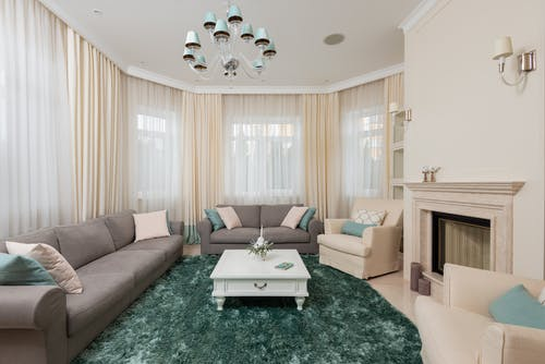 Living room interior with couches and armchairs near table