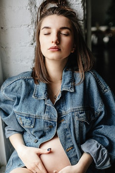 Woman in Blue Denim Button-up Jacket