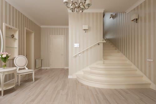 White Wooden Door Near White Round Table