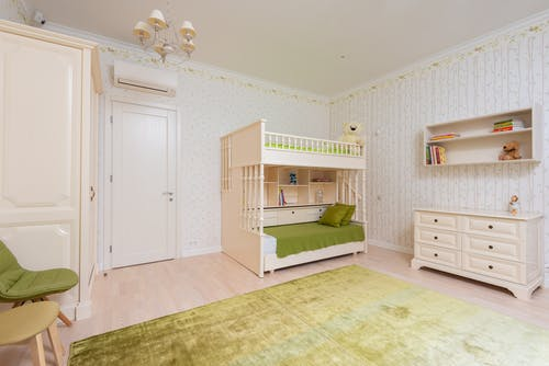 Modern large children bedroom with shelves and cabinet