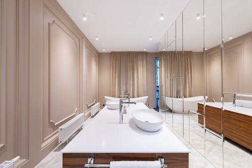 Stylish bathroom in minimalistic style in modern apartment