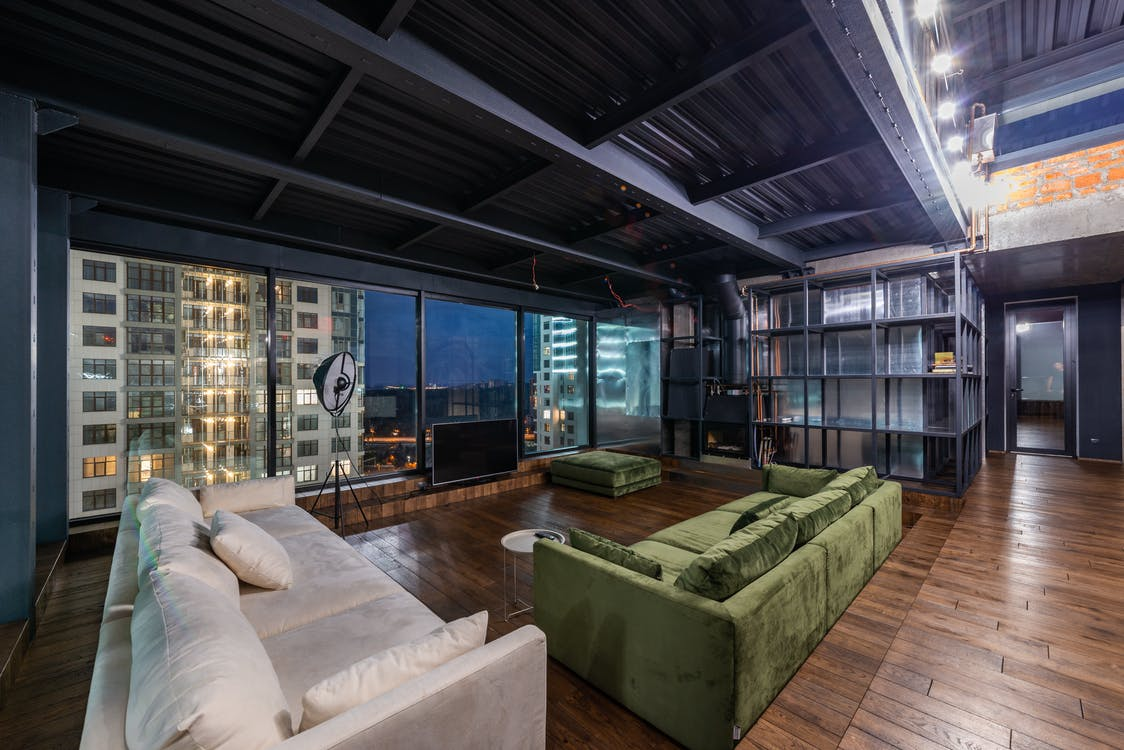 Spacious living room with large sofas and panoramic windows