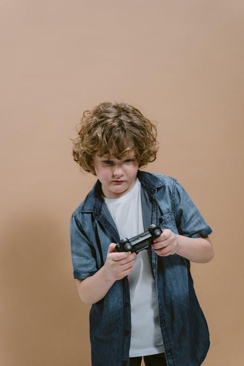 A Boy Holding a Video Game Controller
