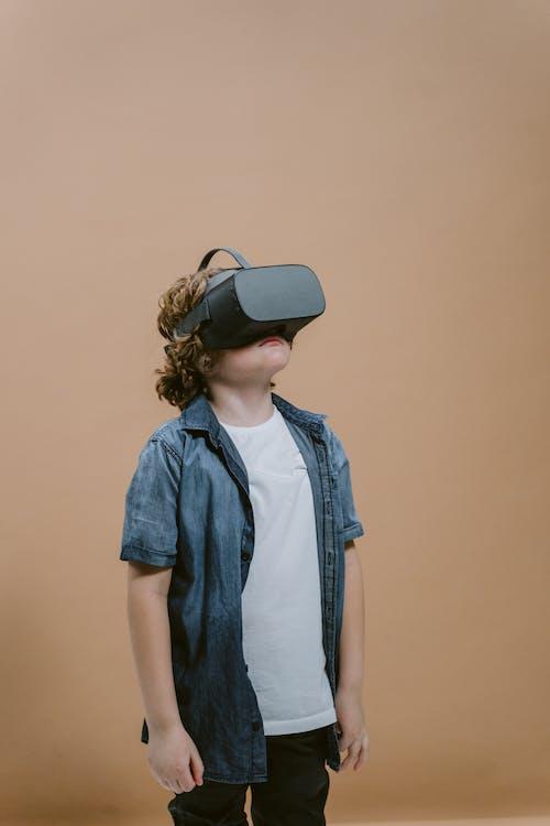 A Boy Playing a Virtual Reality Game