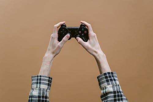 Gratis stockfoto met bruine achtergrond, controller, game controller