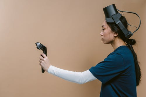 Side View of a Woman Holding a Vr Controller