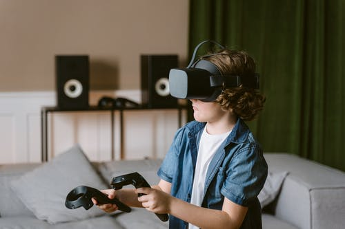 Shallow Focus Photo of a Boy Playing a Virtual Reality Video Game