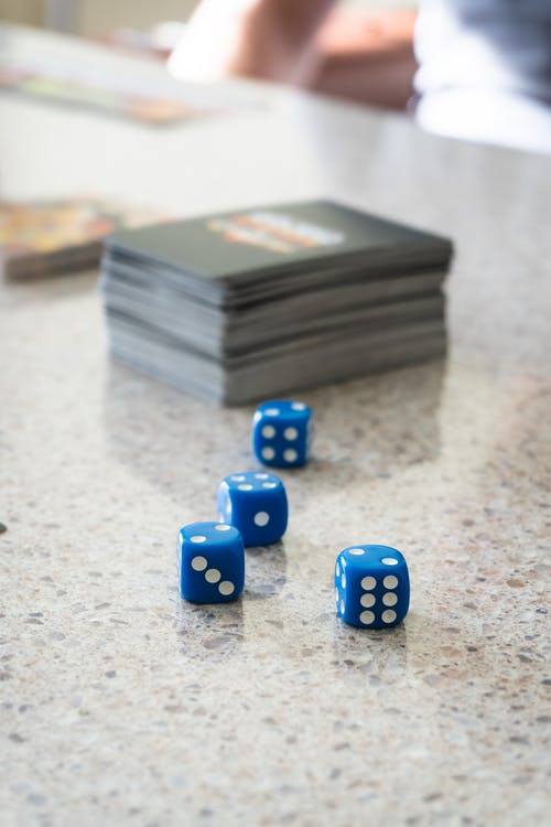 Blue and White Dices on White and Black Marble Table