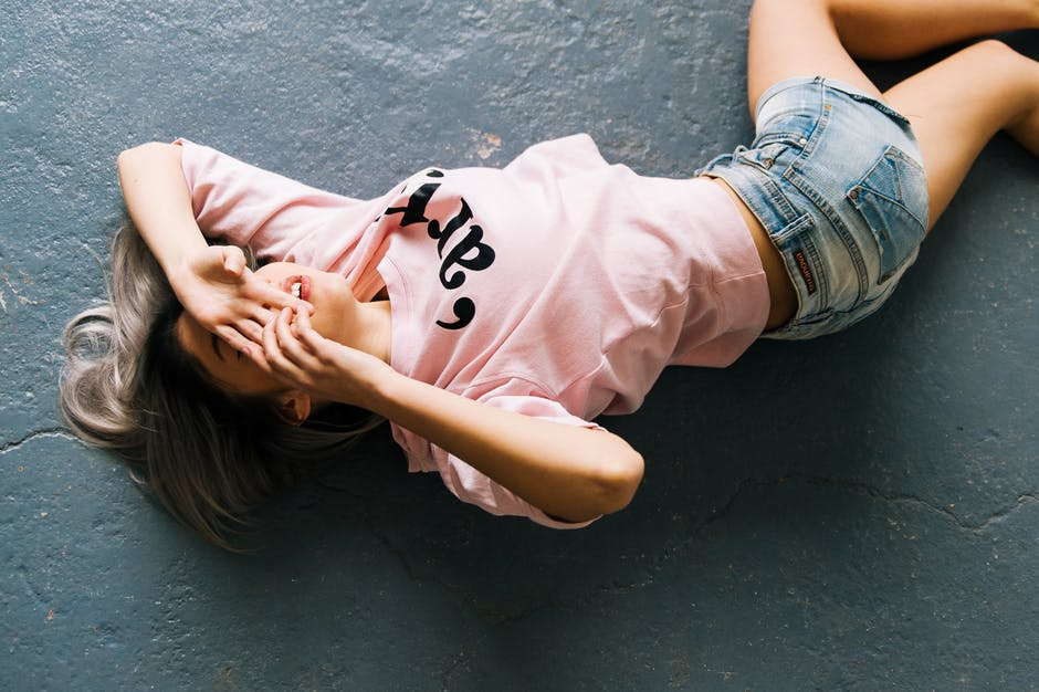 Woman Wearing Pink Printed Crew-neck T-shirt and Blue Faded Denim Shorts