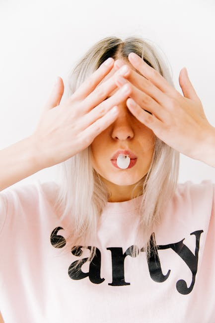 Woman Covering Her Two Eyes
