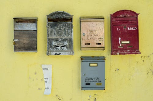 Old Letter Boxes Mounted on a Yellow Wall