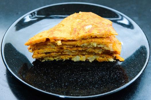 Stack of Pancakes On Round Black Ceramic Plate