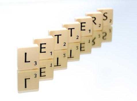 Scrabble Tiles Arranged In Letters Text