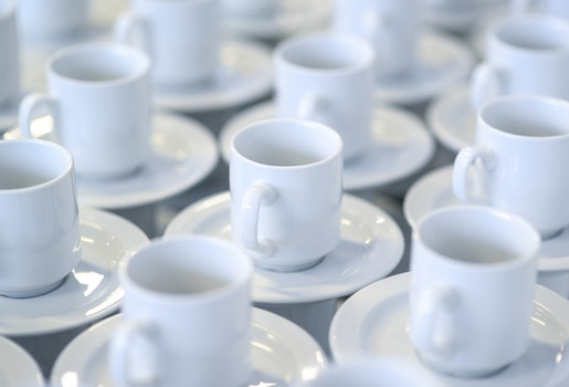 White Ceramic Teacups With Saucers