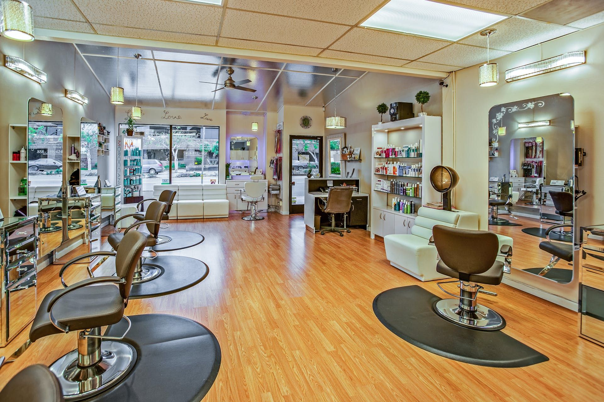 White And Brown Chairs Inside A Salon