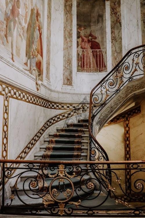 Black Metal Spiral Staircase Near White Wall