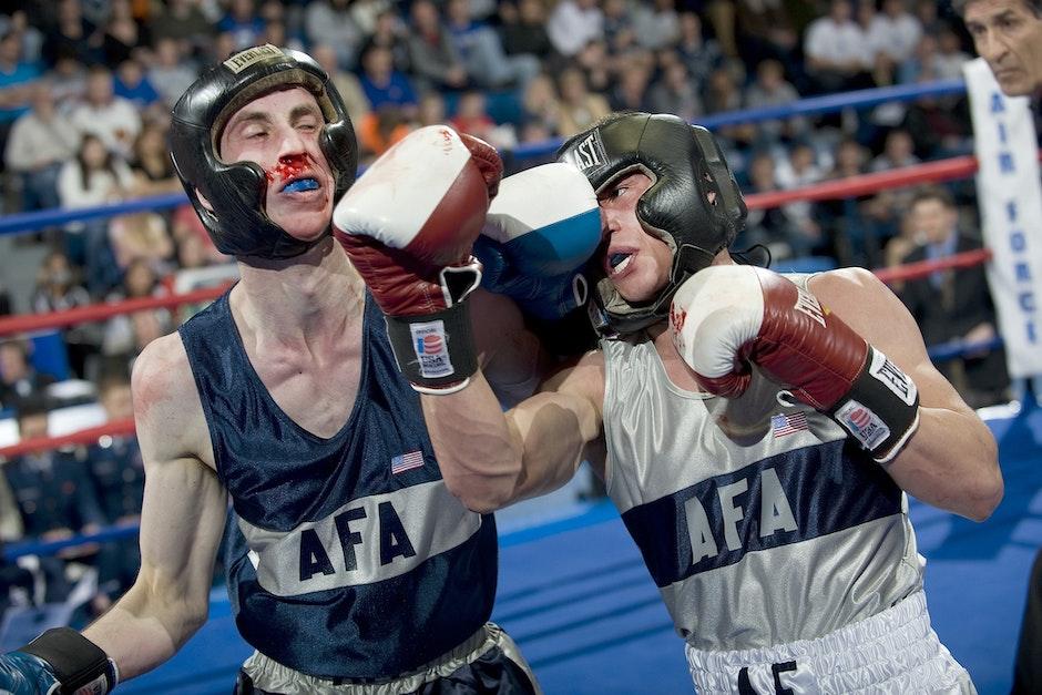 2 Men Boxing on Ring