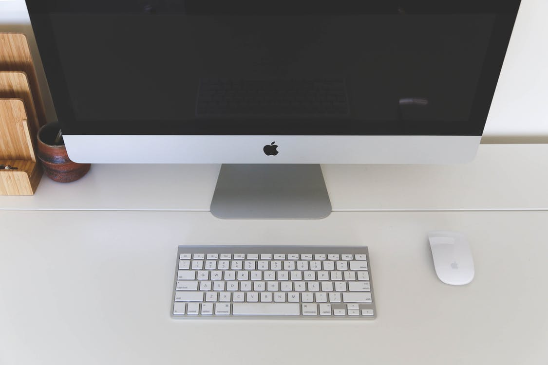 Silver Imac, Apple Magic Mouse, and Apple Keyboard