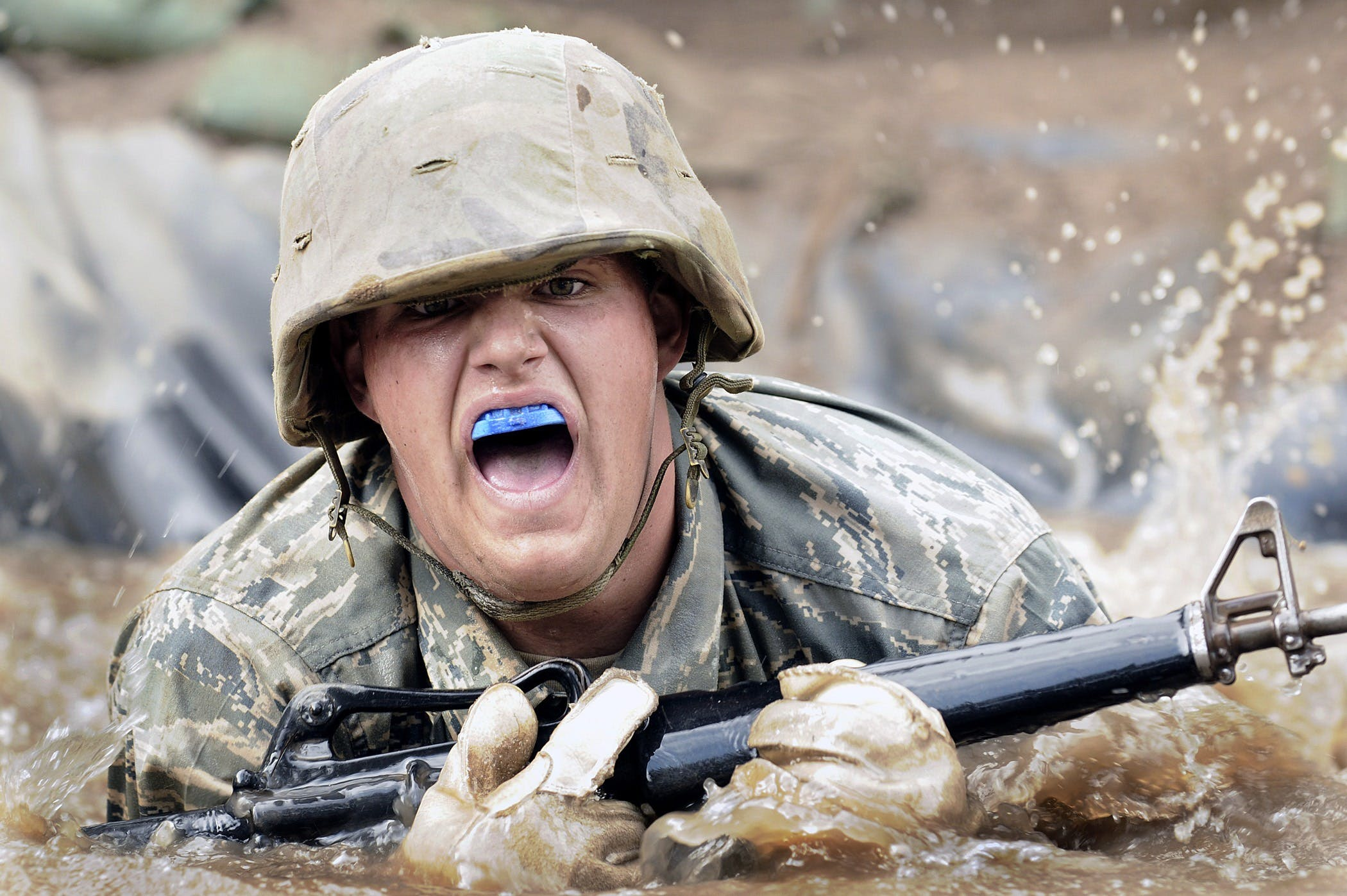 Army Holding Rifle on Water in Close-up Photography