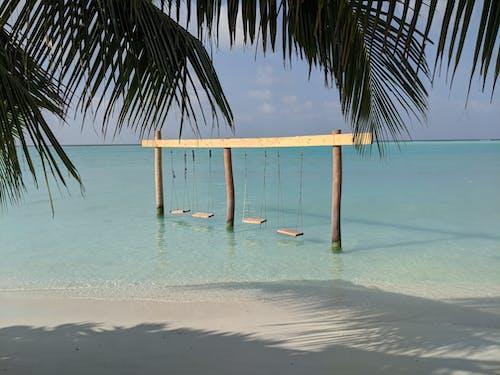 Brown Wooden Beach Chair on Beach