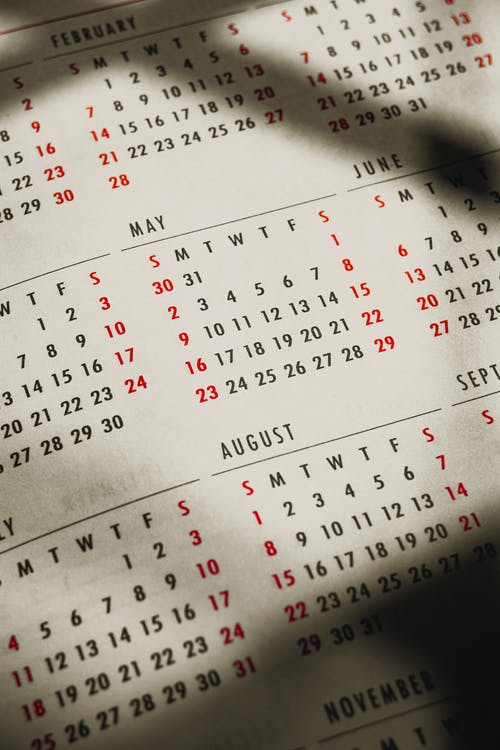 Paper calendar with months and days in sunbeam