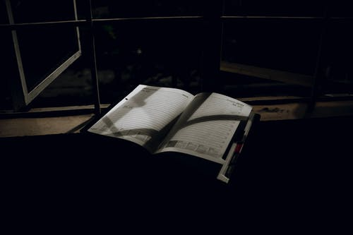 An Open Planner on a Window Sill