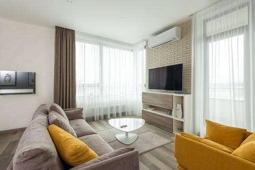 Cozy living room with comfy armchair and couch and modern TV set