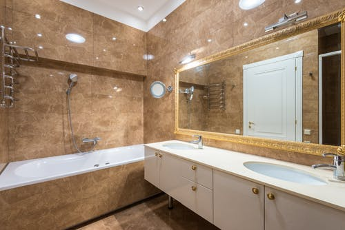 Big mirror hanging above bathroom sinks