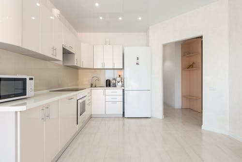 White glossy cabinets in minimalist kitchen