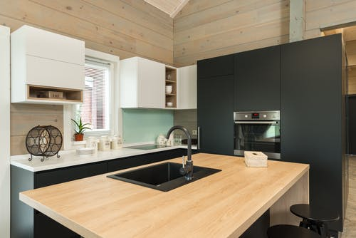 Modern kitchen with counter and built in appliances