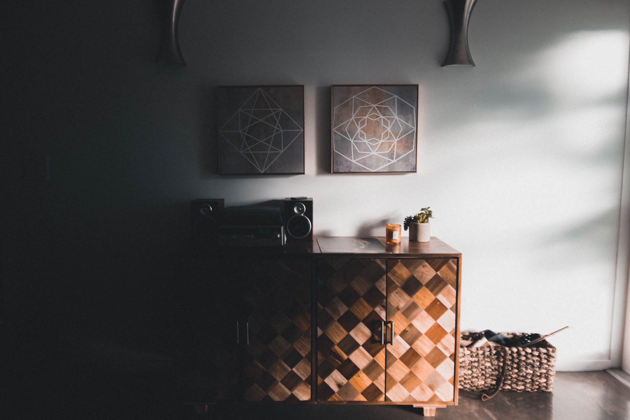 Black Audio Speaker on Brown Wooden Cabinet
