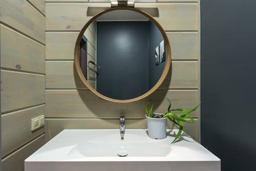 Mirror hanging above sink in bathroom